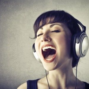 woman singing headphones